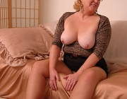 Older Fatty Fanny seductively pulls down her sheer tan pantyhose